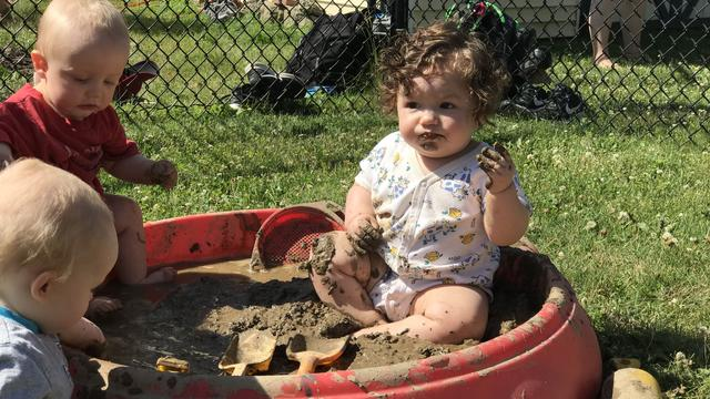 A child playing with mud
