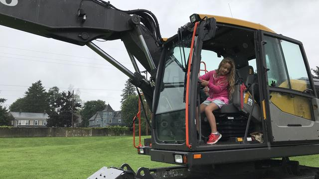 Little Girl Sitting in a Backhoe